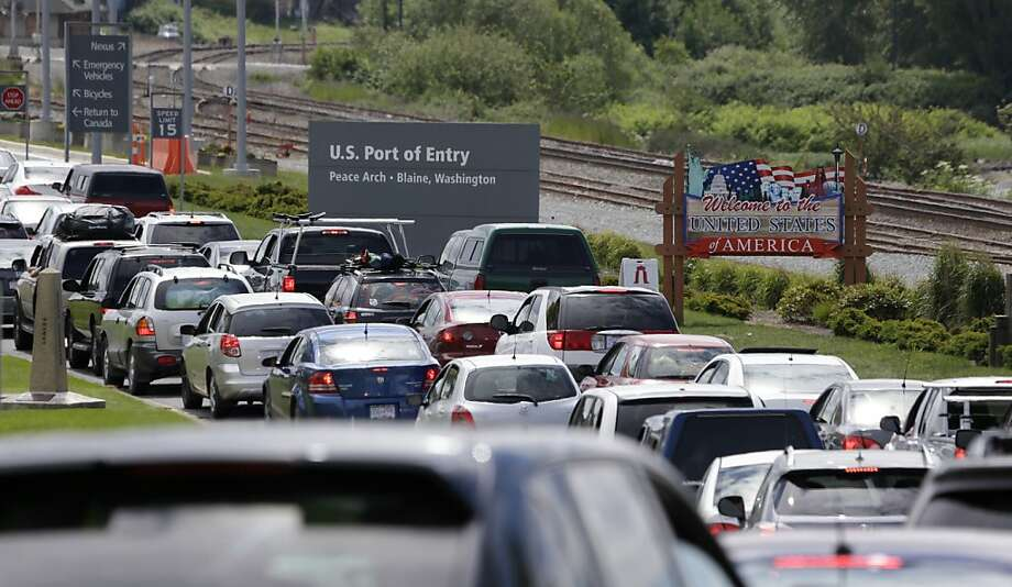 In this photo taken Thursday, May 23, 2013, cars from Canada line up to cross into the U.S. in Blaine, Wash., at Peace Arch State Park. (AP Photo/Elaine Thompson) Photo: Elaine Thompson, Associated Press