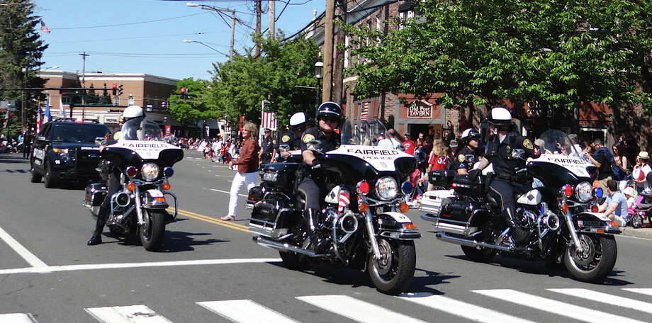 A police motorcycle detail leads the annual Memorial Day parade past thousands of spectators in downtown Fairfield on MOnday morning.  FAIRFIELD CITIZEN, CT 5/27/13 Photo: Mike Lauterborn / Fairfield Citizen contributed