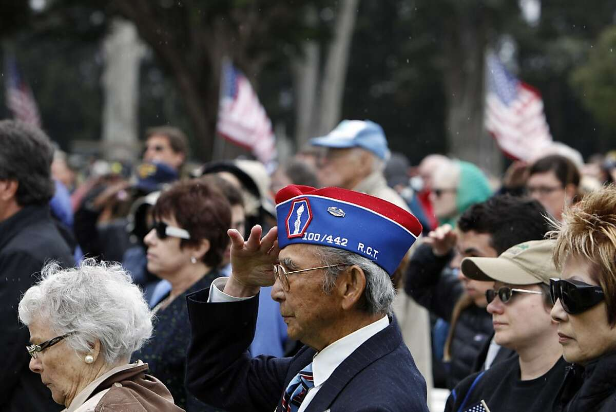 Frank Mizufuka, one of seven WWII veterans honored with the Legion of Honor Medal by France, salutes as taps is played near the end of Memorial Day Ceremonies at the National Cemetery in San Francisco, Calif., on Monday, May 27, 2013.