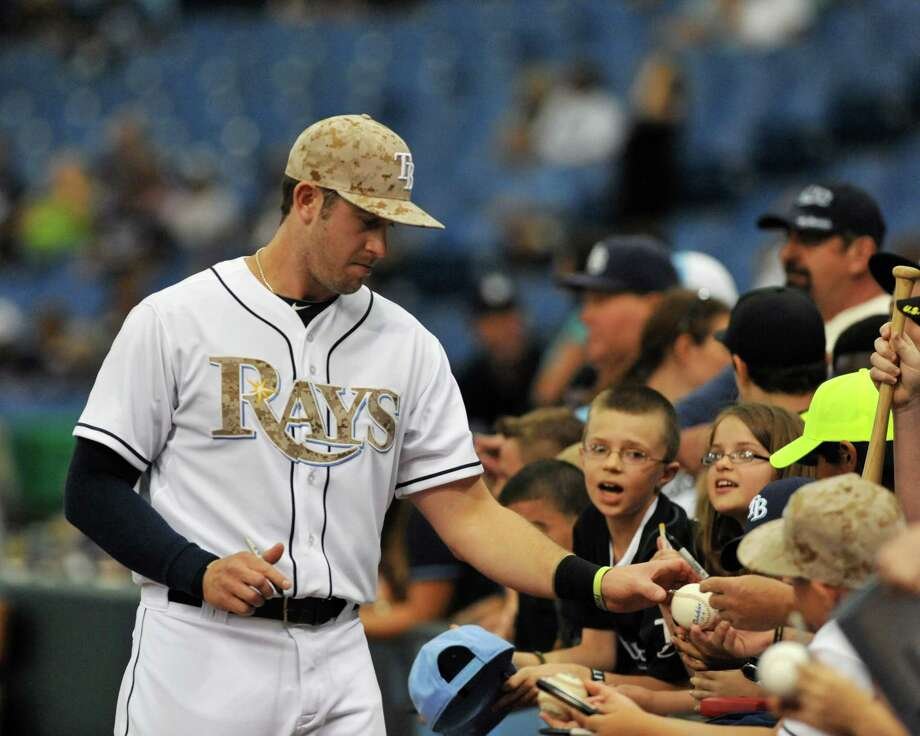Infielder Evan Longoria #3 of the Tampa Bay Rays wears a camouflage cap on Memorial Day and signs autographs before play against the Miami Marlins May 27, 2013 at Tropicana Field in St. Petersburg, Florida. Photo: Al Messerschmidt, Getty Images / 2013 Getty Images