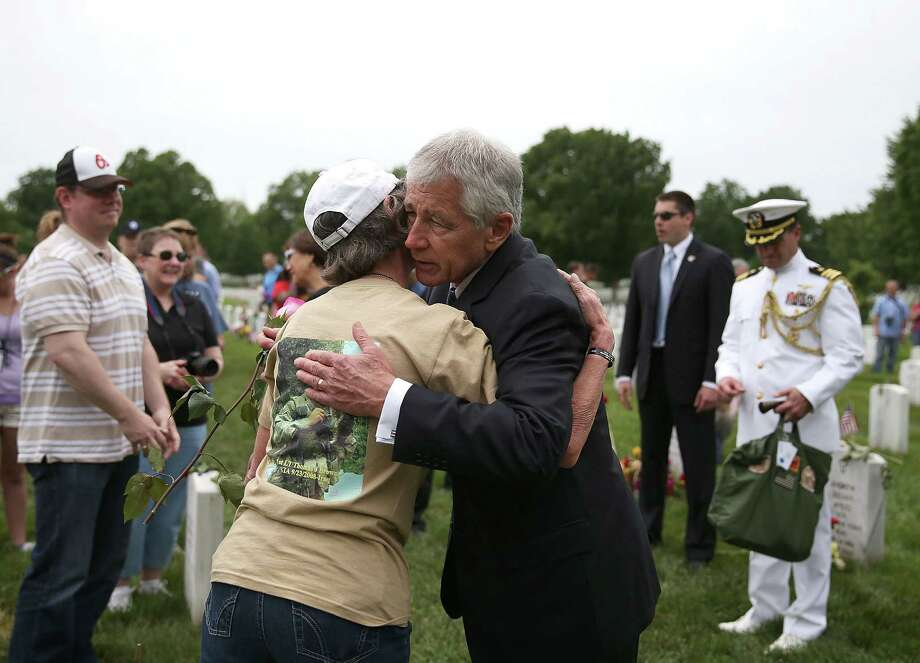 U.S. Secretary of Defense Chuck Hagel greets people while visiting section 60 at Arlington Cemetery, May 27, 2013 in Arlington, Virginia. For Memorial Day President Obama layed a wreath at the Tomb of the Unknowns, paying tribute to military veterans past and present who have served and sacrificed their lives for their country. Photo: Mark Wilson, Getty Images / 2013 Getty Images