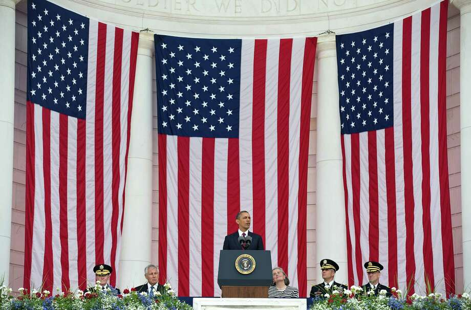 U.S. President Barack Obama speaks during a ceremony on Memorial Day at the Tomb of the Unknowns at Arlington National Cemetery on May 27, 2013 in Arlington, Virginia. For Memorial Day President Obama is paying tribute to military veterans past and present who have served and sacrificed their lives for their country. Photo: Pool, Getty Images / 2013 Getty Images