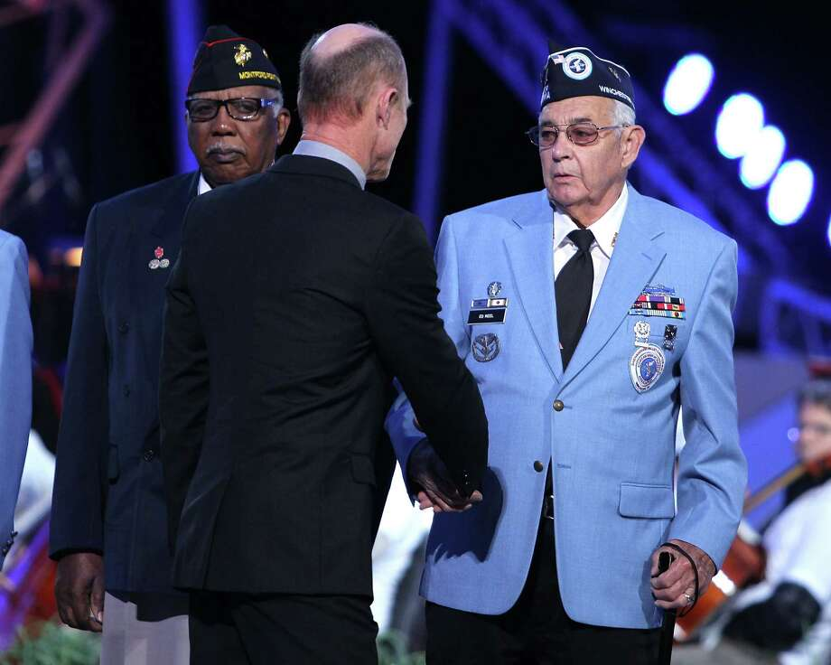 Actor Ed Harris (C) shakes hands with Korean War vets during the 2013 PBS National Memorial Day Concert Rehearsals at the US Capitol on May 25, 2013 in Washington, DC.  (Photo by Paul Morigi/WireImage) Photo: Paul Morigi, Getty Images / 2013 Paul Morigi