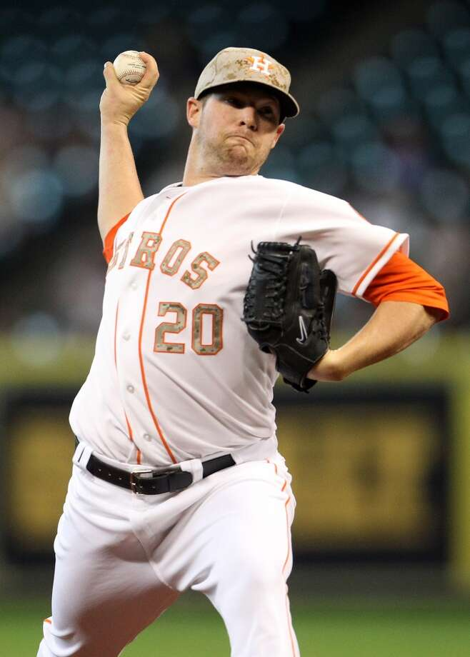 Bud Norris of the Astros makes a pitch against the Rockies.