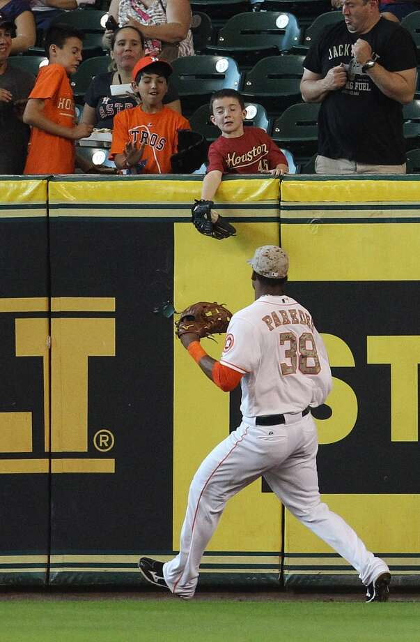 Astros right fielder Jimmy Paredes chases a double hit by Carlos Gonzalez of the Rockies during the first inning.
