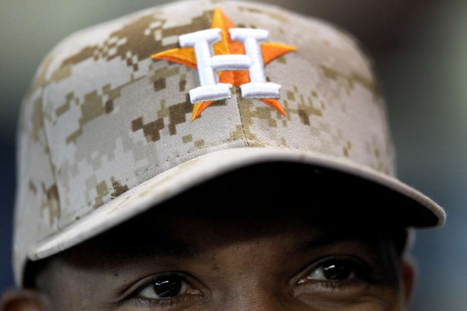 Astros manager Bo Porter wears a camo-style baseball cap in honor of Memorial Day