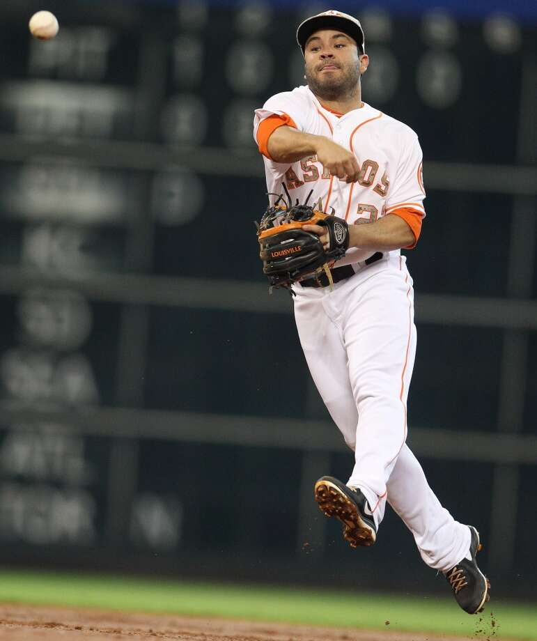 Astros second baseman Jose Altuve makes a throw to first base.