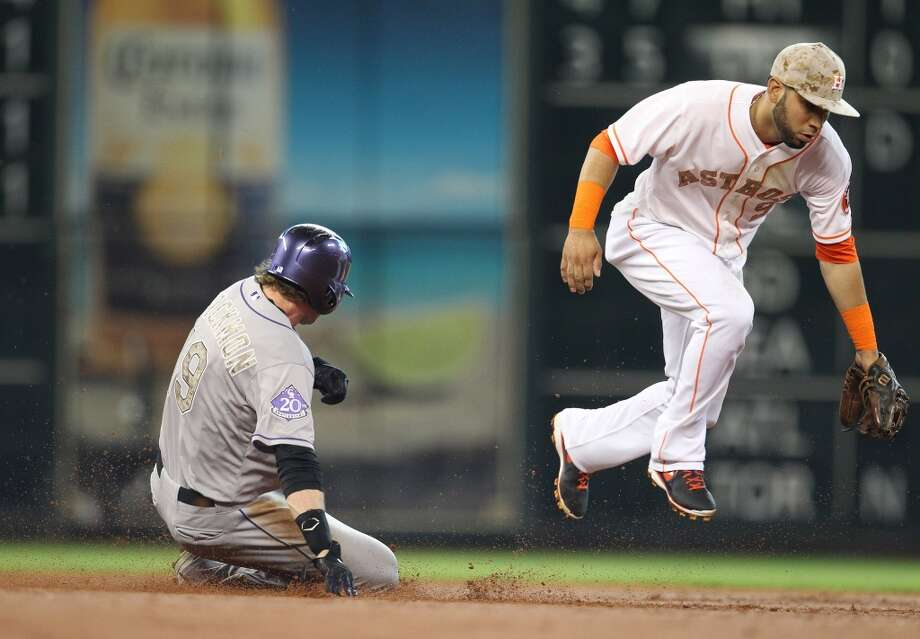 Charlie Blackmon of the Rockies steals second base as Astros shortstop Marwin Gonzalez can't apply the tag.