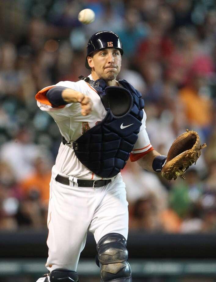 Astros catcher Jason Castro makes a throw.