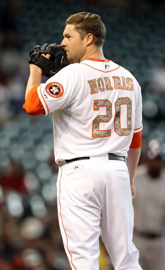 Astros pitcher Bud Norris looks on at the mound.