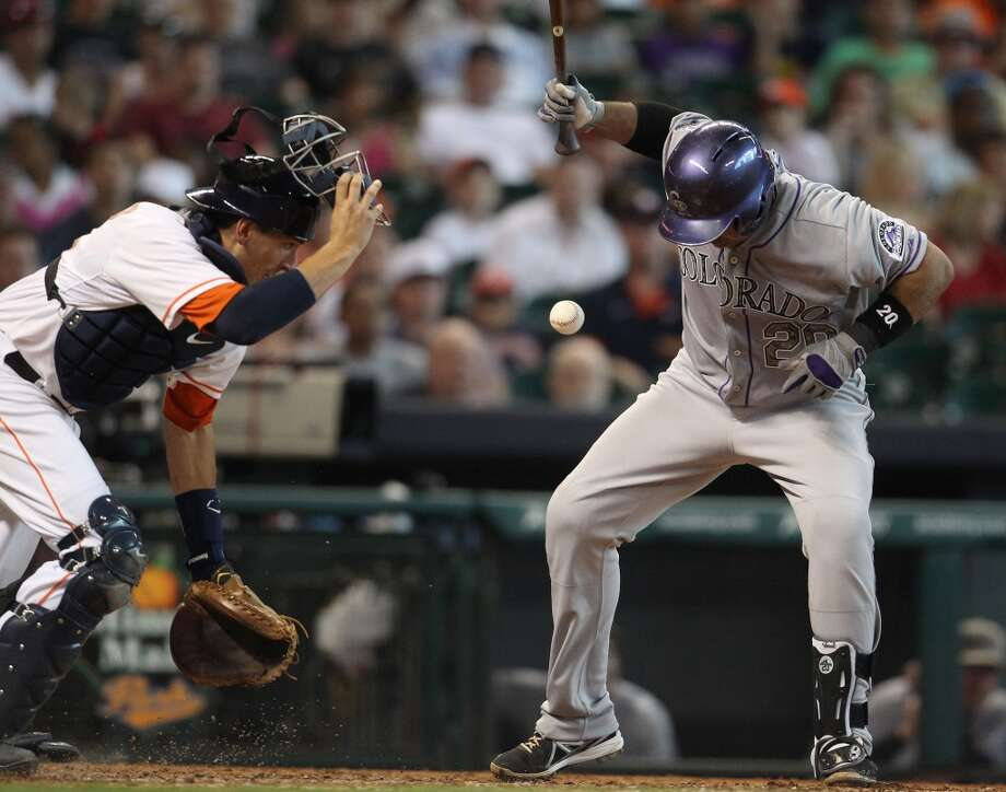 Astros catcher Jason Castro tries to get a hold of a foul ball.