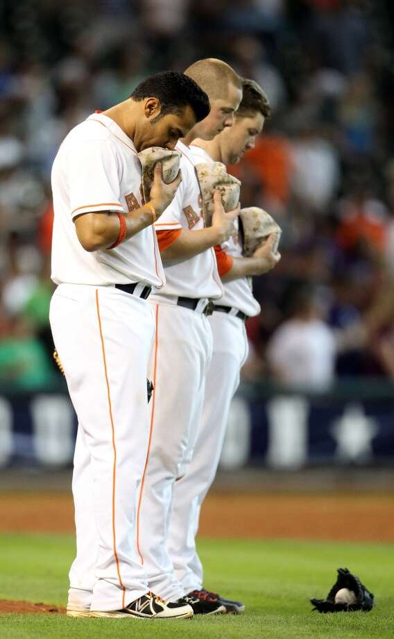 Astros players pause for a moment of silence commemorating Memorial Day.