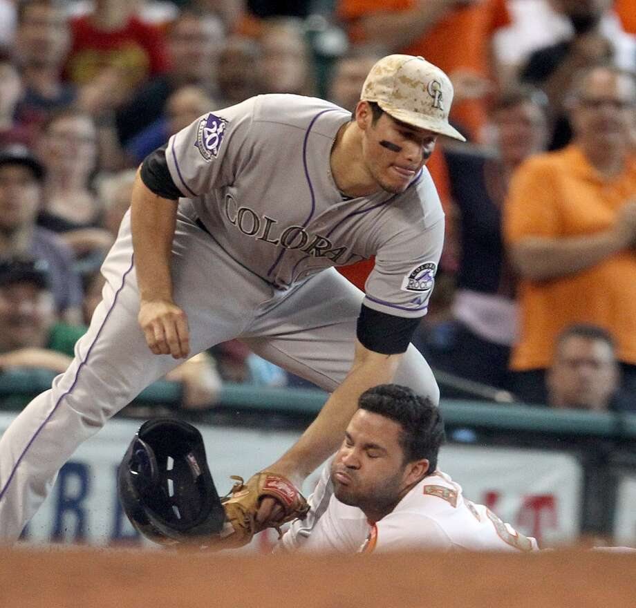 Astros second baseman Jose Altuve is called out at third base after trying to stretch a double into a triple.