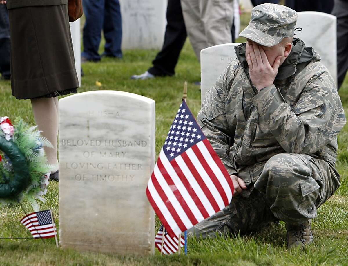 SSgt. Timothy Taaffe wipes a tear as he spends time at his father's grave duruing Memorial Day ceremonies at the National Cemetery in San Francisco, Calif., on Monday, May 27, 2013.