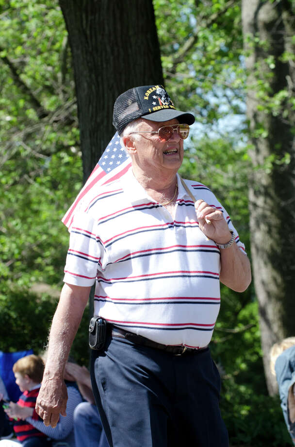 Korean War Veteran Peter Orrico, Ordnance, of Cos Cob, marches in the Memorial Day parade on Sound Beach Avenue in Old Greenwich on Monday, May 27, 2013. Photo: Amy Mortensen / Connecticut Post Freelance