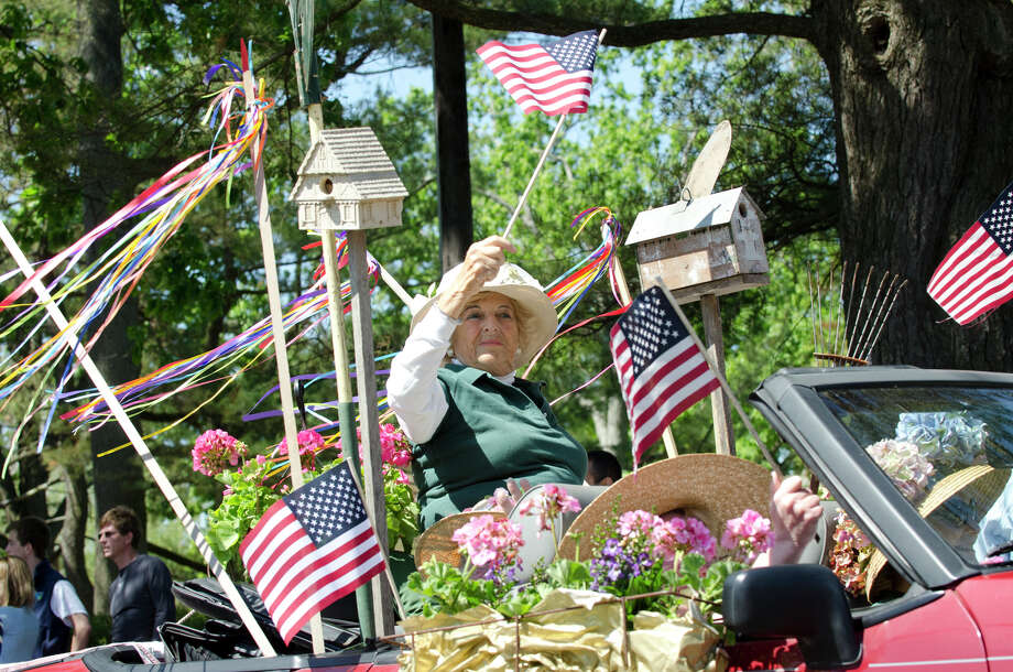 The Greenwich Garden Club participates in the Memorial Day parade on Sound Beach Avenue in Old Greenwich on Monday, May 27, 2013. Photo: Amy Mortensen / Connecticut Post Freelance