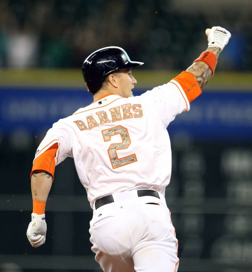 Astros right fielder Brandon Barnes reacts after his ground rule double won the game.