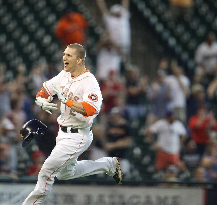 Astros right fielder Brandon Barnes reacts after his ground rule double in the 12th inning.