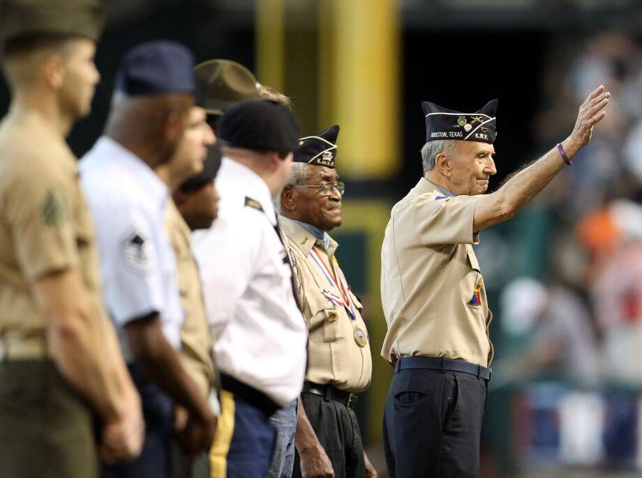 Korean War veteran Jim Duncan waves to the crowd during pre-game Memorial Day ceremonies.