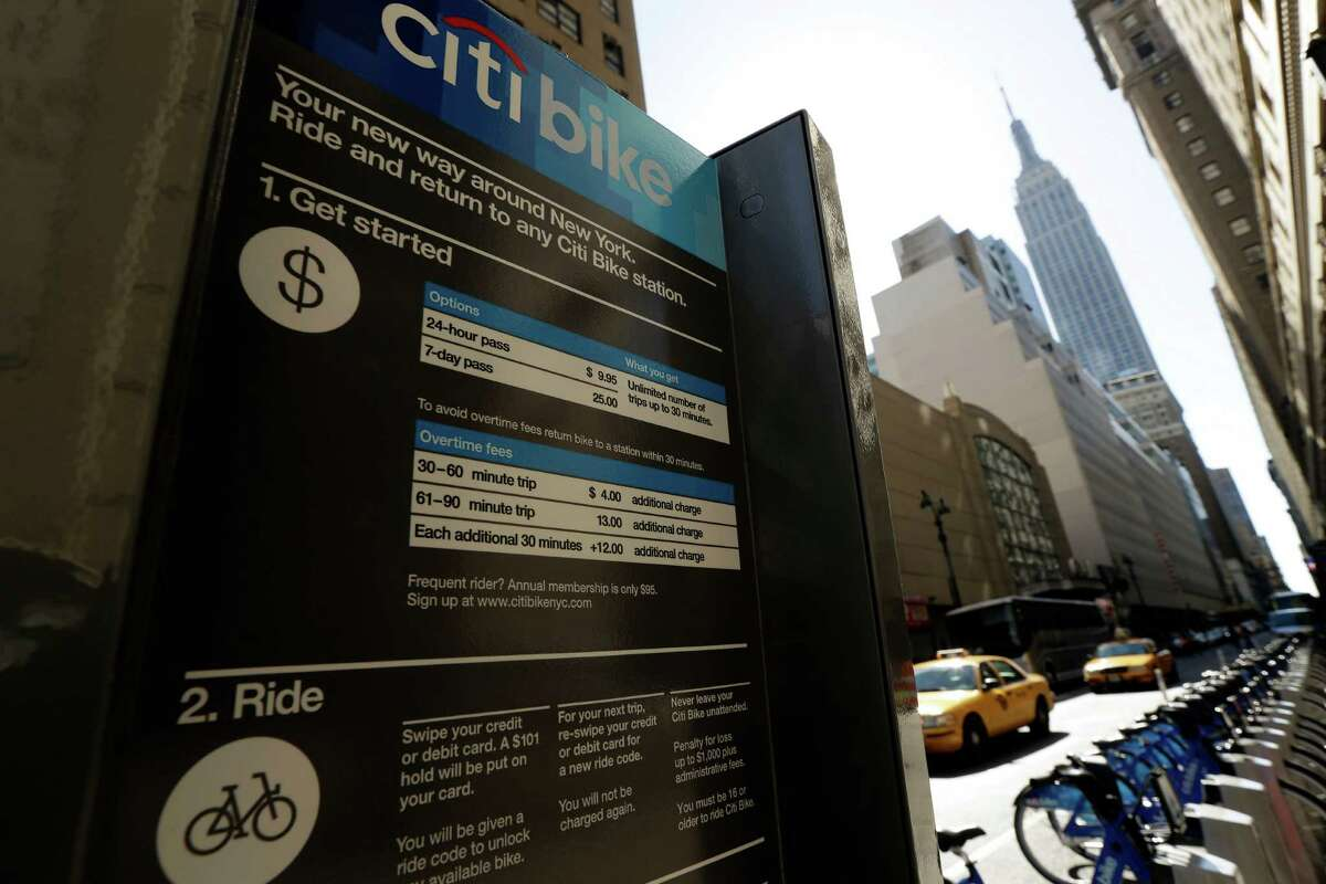 Bikes sit at a docking station as part of a bike share program Monday, May 27, 2013, in New York. The privately funded Citi Bike bike-share program will launch with 6,000 bikes at 330 docking stations in Manhattan and parts of Brooklyn. Officials hope to expand to 10,000 bikes and 600 docking stations in Manhattan, Brooklyn and Queens. (AP Photo/Frank Franklin II)