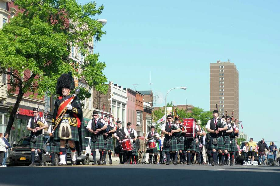 members of the City of Albany Pipe Band march down Central Ave. during the Albany Memorial Day Parade on Monday, May 27, 2013 in Albany, NY.   (Paul Buckowski / Times Union) Photo: Paul Buckowski