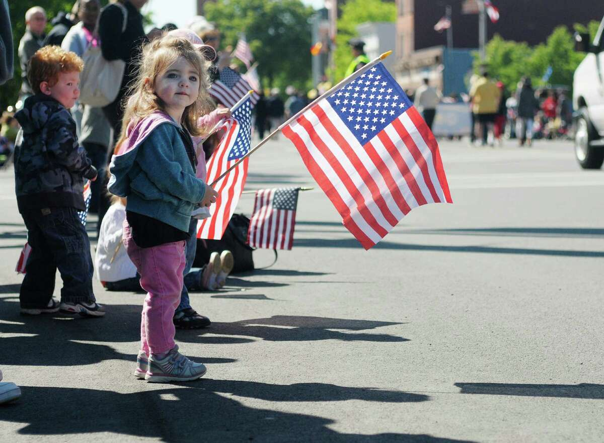 Brooke Belleville, 2, of Menands, watches the parade come down Central Ave. during her first Albany Memorial Day Parade on Monday, May 27, 2013 in Albany, NY. (Paul Buckowski / Times Union)