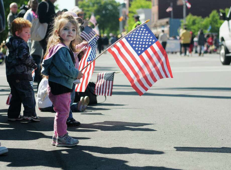 Brooke Belleville, 2, of Menands, watches the parade come down Central Ave. during her first  Albany Memorial Day Parade on Monday, May 27, 2013 in Albany, NY.   (Paul Buckowski / Times Union) Photo: Paul Buckowski