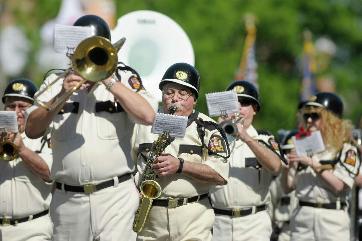 Members of the Fort Crailo American Legion Yankee Doodle Band perform as they march down Central Ave. during the Albany Memorial Day Parade on Monday, May 27, 2013 in Albany, NY. (Paul Buckowski / Times Union)