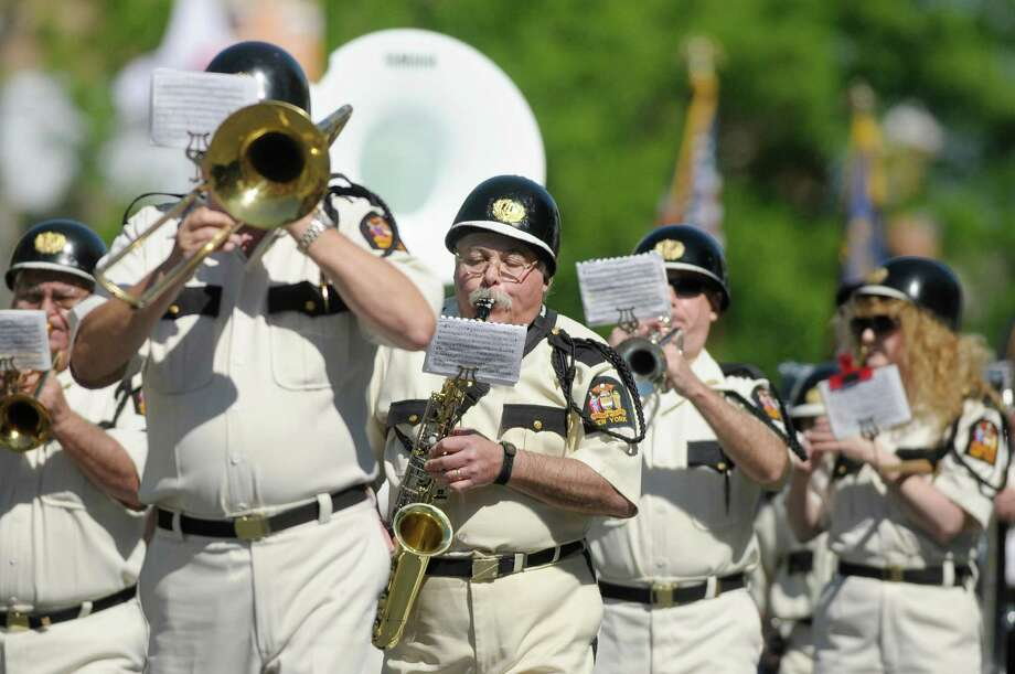 Members of the Fort Crailo American Legion Yankee Doodle Band perform as they march down Central Ave. during the Albany Memorial Day Parade on Monday, May 27, 2013 in Albany, NY.   (Paul Buckowski / Times Union) Photo: Paul Buckowski