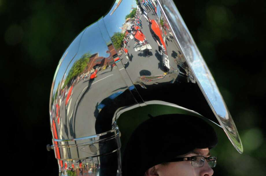 Drummers in the Mohonasen Marching Band are reflected in the tuba of a fellow band member as they took part in the  Albany Memorial Day Parade on Monday, May 27, 2013 in Albany, NY.   (Paul Buckowski / Times Union) Photo: Paul Buckowski