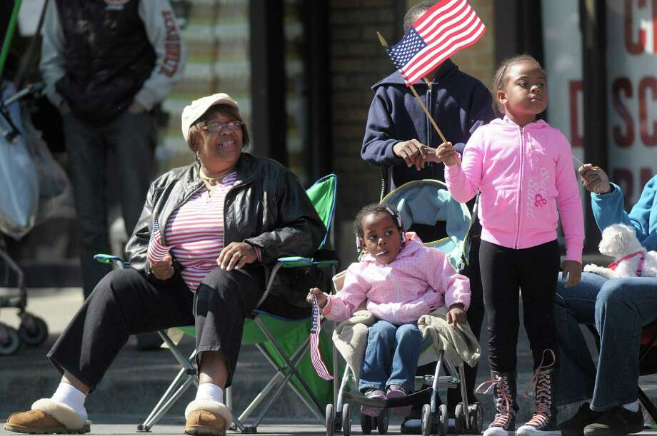 Joann Curtis, left, of Albany watches the parade with her grand children, sisters, Sharai Canal, 2, and Shacki Stuart, 6, during the  Albany Memorial Day Parade on Monday, May 27, 2013 in Albany, NY.   (Paul Buckowski / Times Union) Photo: Paul Buckowski