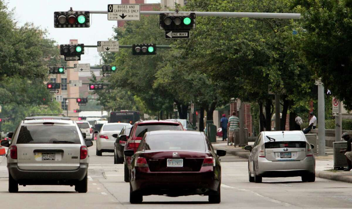 Multiple lights along San Jacinto, northward are in synchronization as traffic flows in downtown Houston.