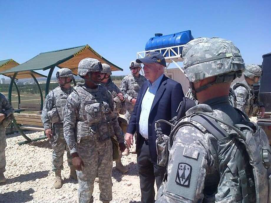 Sen. John McCain, R.-Ariz., visits troops at a Patriot missile site in southern Turkey on Monday, a day he also met with top Syrian rebels. Photo: Associated Press