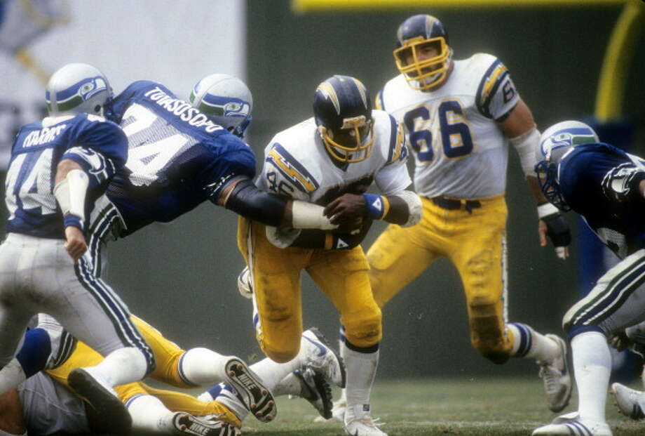 Defensive tackle: Manu Tuiasosopo (1979-83) Pro Bowl: no | All-Pro: no  Tuiasosopo was a starter for most of his five years in Seattle. Pictured above as No. 74, he is perhaps now best known in Seattle for his children, many of whom became sports stars themselves at the University of Washington.   Photo: Focus On Sport, Getty Images / 1980 Focus on Sport