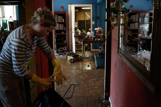 Rhoda P. Council cleans her flooded home in the neighborhood next to Mission Espada in San Antonio on Monday, May 27, 2013. The family has lived there since 1996 and five generations of her husband's family live in the neighborhood. Photo: Lisa Krantz, San Antonio Express-News / San Antonio Express-News
