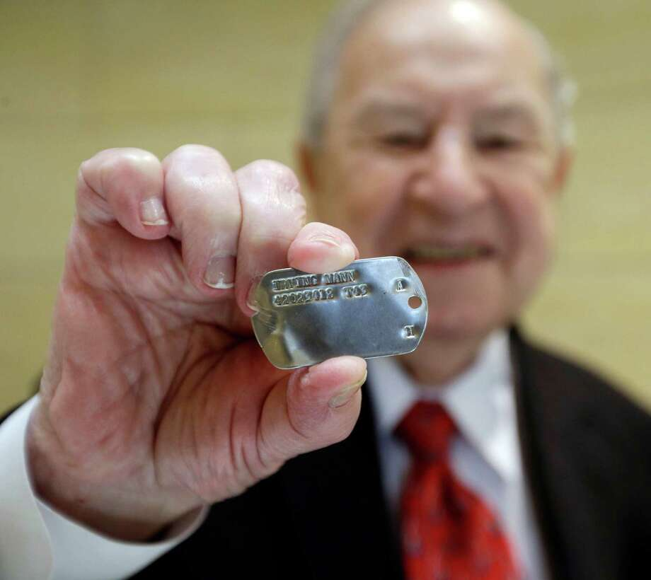 A French woman said she found the dog tag of World War II veteran Irving Mann in her barley field. Photo: David Duprey, STF / AP