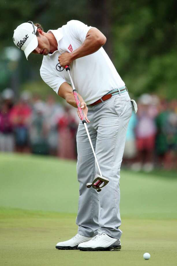 (FILE PHOTO) The Royal and Ancient Golf Club in St Andrews and the United States Golf Association have moved to outlaw the use of anchored putting strokes from 2016.   AUGUSTA, GA - APRIL 14:  Adam Scott of Australia putts on the 8th hole during the final round of the 2013 Masters Tournament at Augusta National Golf Club on April 14, 2013 in Augusta, Georgia.  (Photo by Andrew Redington/Getty Images) Photo: Andrew Redington / 2013 Getty Images
