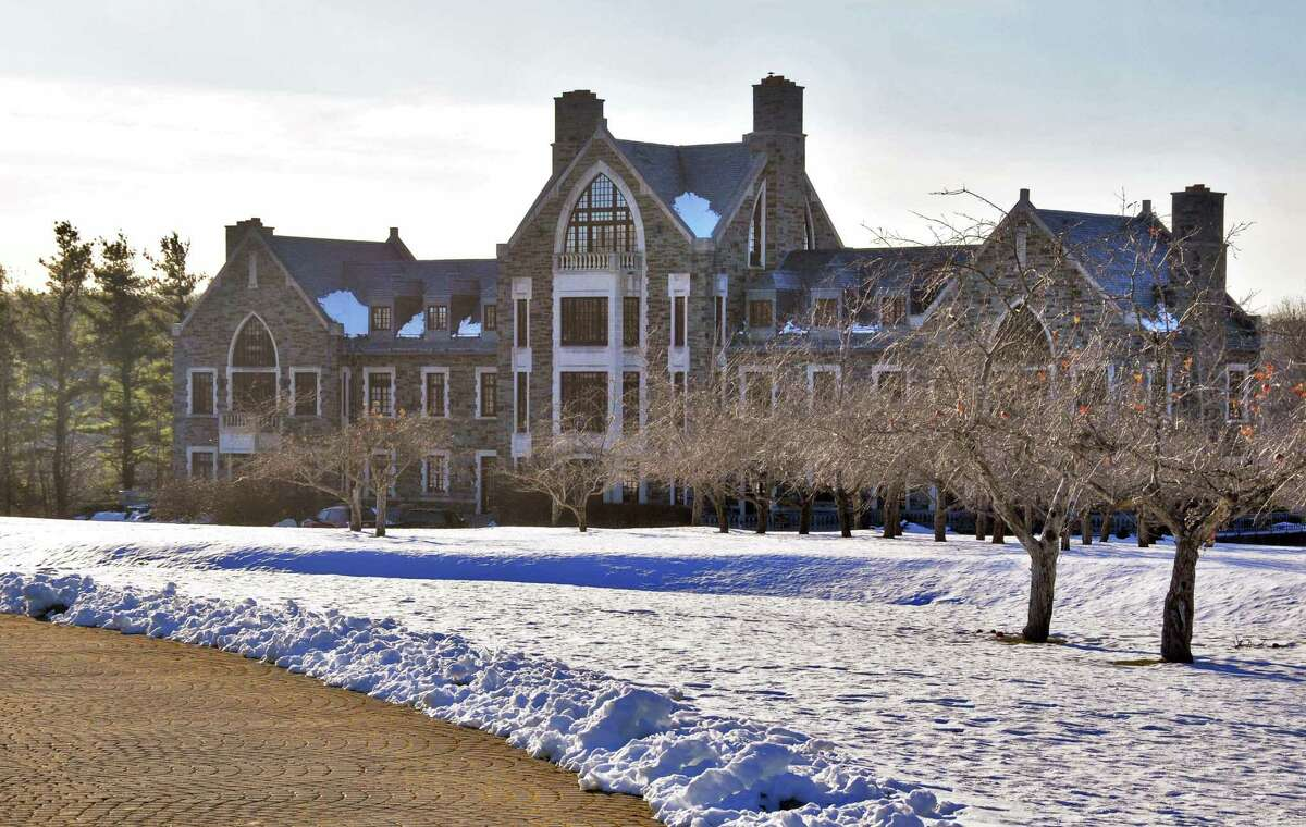 The Justice Department is moving to seize this Rexford mansion whose owner, Annie George, was convicted in March of harboring an illegal alien. (John Carl D'Annibale / Times Union)