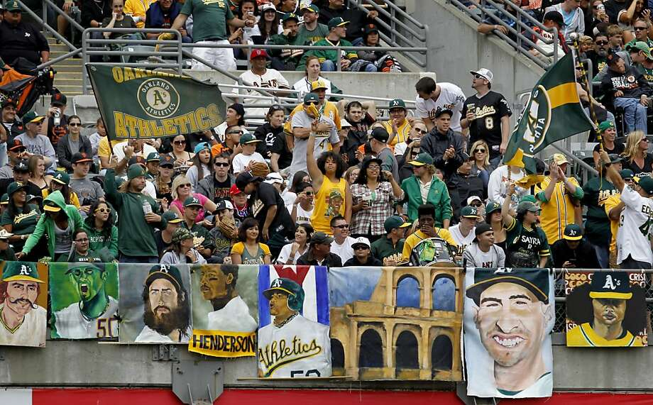 Oakland A's fans bring out the paintings as they celebrate a home run Monday May 27, 2013. The Oakland A's beat the San Francisco Giants 4-1 on Memorial Day 2013 at the O.co coliseum in Oakland, Calif. Photo: Brant Ward, The Chronicle