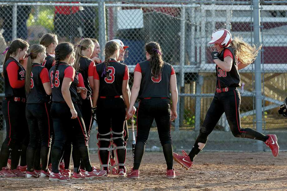 Mike Ross Connecticut Post freelance -Masuk High School's #30 Melissa Peet gets congratulated by teammates at home plate after Peet's home run during Monday evening SWC softball Championship game against Lauralton Hall.  Masuk would win 7-0. Photo: Mike Ross / Mike Ross Connecticut Post freelance -www.mikerossphoto.com