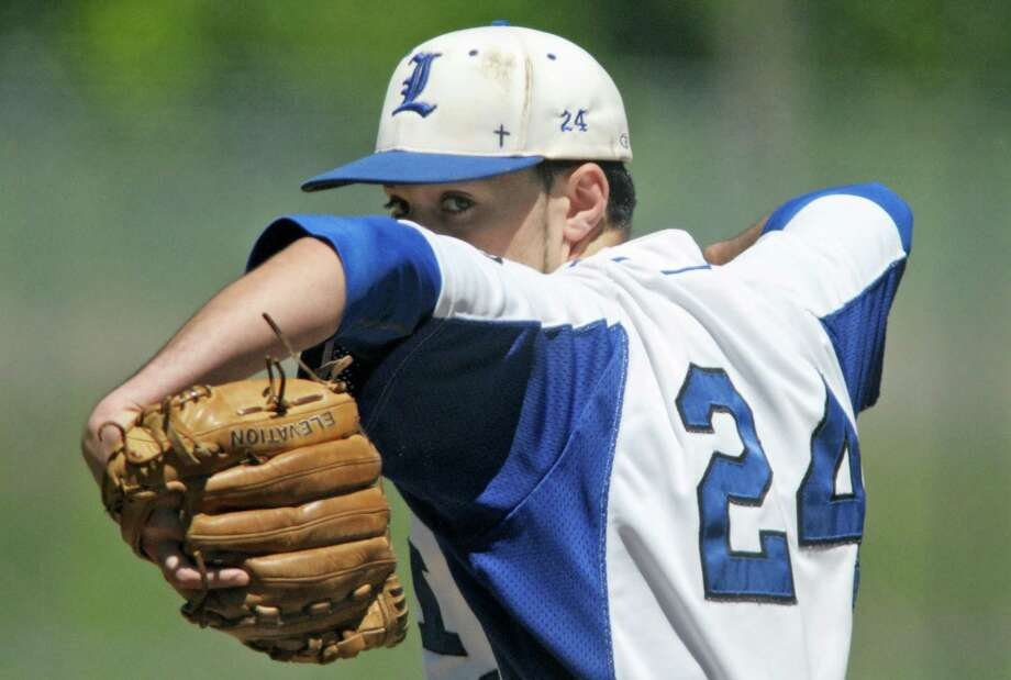 Dom Razzano of La Salle winds up to deliver a pitch  in their game against Bethlehem  on Monday, May 27, 2013 in Troy, NY.