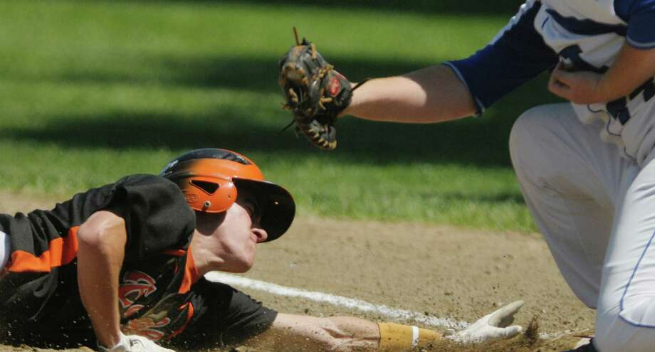 Nick DiNapoli of Bethlehem slides safely back into first in their game against La Salle  on Monday, May 27, 2013 in Troy, NY.    (Paul Buckowski / Times Union) Photo: Paul Buckowski