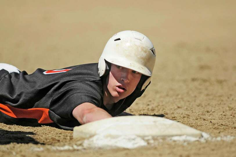 Sam Powers of Bethlehem slides safely back into first in their game against La Salle  on Monday, May