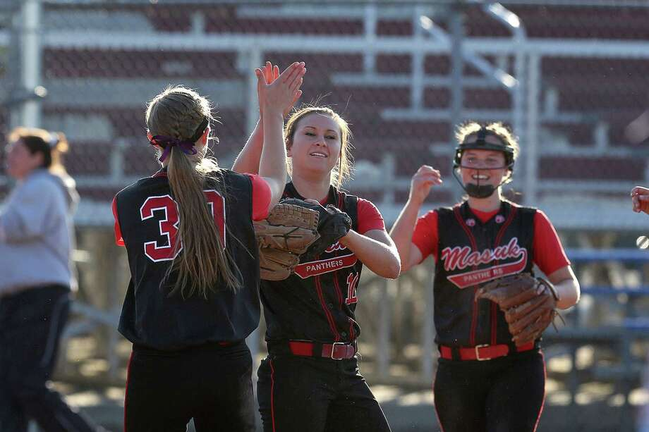 Mike Ross Connecticut Post freelance -Masuk High School's pitcher #10 Tatum Buckley gets congratulated by teammates after Buckley's line-drive catch from a Lauralton Hall batter during  Monday's evening SWC softball Championship game. Masuk would win 7-0. Photo: Mike Ross / Mike Ross Connecticut Post freelance -www.mikerossphoto.com