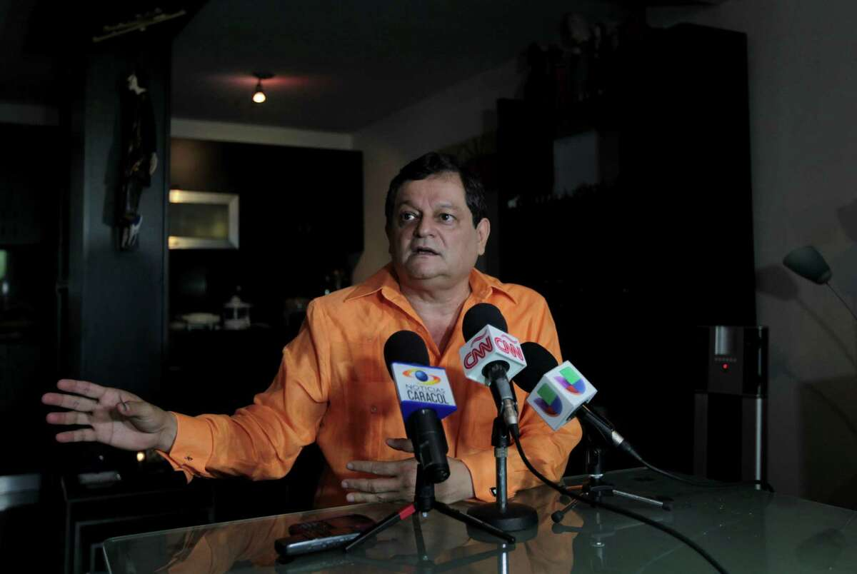 Venezuelan talk show host Francisco Bautista gives a news conference at his home in Caracas after he was fired Monday.