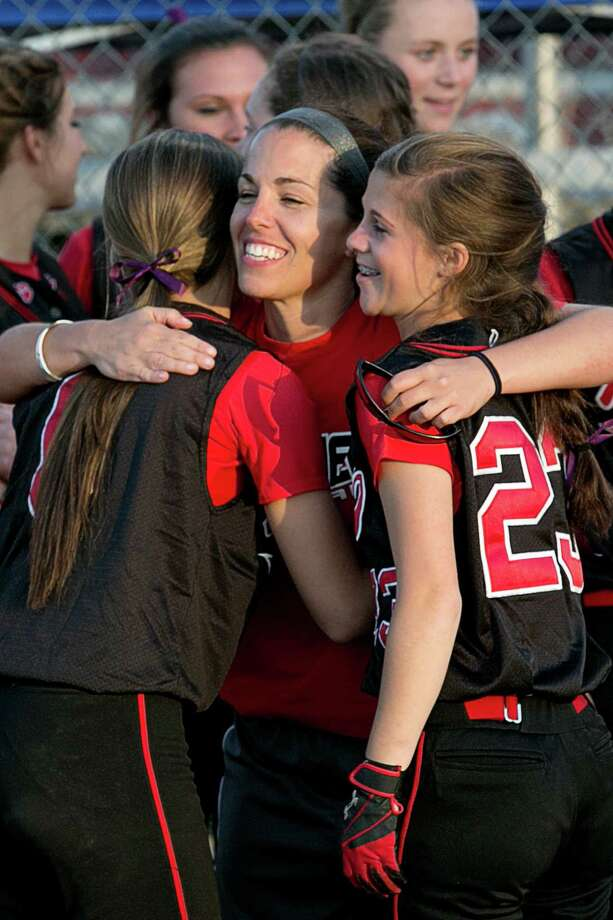 Mike Ross Connecticut Post freelance -Masuk High School's #23 Becca Tillotaon and #9 Ashely Fedor get congratulated by coach after team's victory over Lauralton Hall during Monday evening SWC softball Championship game. Masuk would win 7-0. Photo: Mike Ross / Mike Ross Connecticut Post freelance-www.mikerossphoto.com