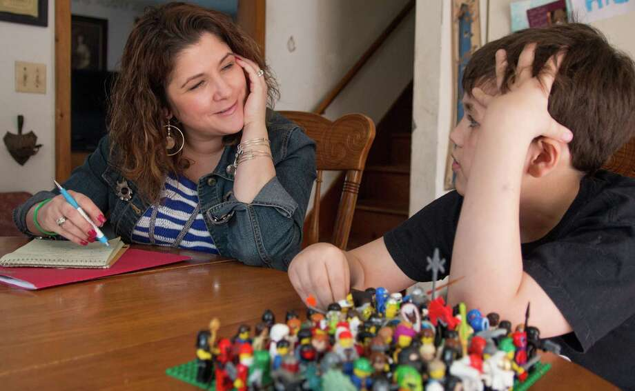 EMPS Crisis Clinician Heather Kunkel holds a follow-up home visit with Joey Smith, 10, of Thomaston, Conn. Photo: Tony Bacewicz / Connecticut Post Contributed