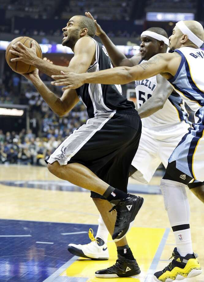 San Antonio Spurs' Tony Parker drivers to the basket between Memphis Grizzlies' Zach Randolph and Memphis Grizzlies' Jerryd Bayless during first half action in Game 4 of the 2013 Western Conference finals Monday May 27, 2013 at the FedEx Forum in Memphis, Tenn.