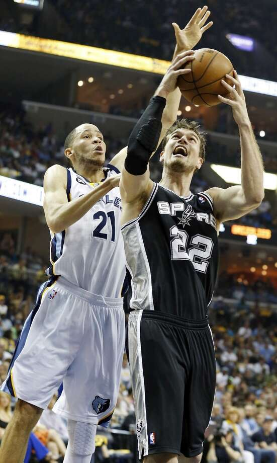 San Antonio Spurs' Tiago Splitter shoots around Memphis Grizzlies' Tayshaun Prince during first half action in Game 4 of the 2013 Western Conference finals Monday May 27, 2013 at the FedEx Forum in Memphis, Tenn.