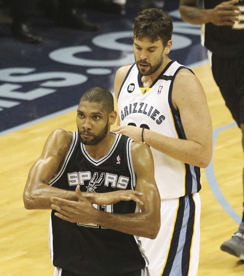 Spurs' Tim Duncan (21) reacts after making a shot against Memphis Grizzlies' Marc Gasol (33) in Game 4 of the 2013 Western Conference Finals at the FedEx Forum in Memphis on Monday, May 27, 2013. (Kin Man Hui/San Antonio Express-News)